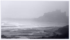 Bamburgh Castle in the mist, 1989 (Keith Halton) Tags: seascape castle beach misty landscape northumberland bamburghcastle