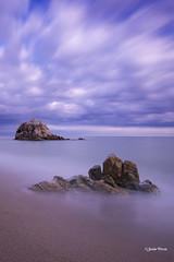 De roca en roca (SoniaPerea) Tags: longexposure sea sky beach rock clouds landscape serenity nubes largaexposicion