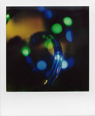Blue Bokeh (ale2000) Tags: blue black macro verde green closeup analog spiral polaroid sx70 lights bokeh blu 600 instant luci nero luce impossible instantfilm spiraling instantanalog