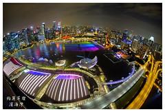 Grand Prismatic Bay (|SiLeNcE|) Tags: singapore fisheye fujifilm marinabay singaporeskyline samyang marinabaysands wishingspheres singaporecountdown marinabayskyline mbsskypark marinabaycoundown marinabaycountdown2016 marinabaybluehour