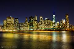 Passing Illumination (Adam Blackner Photography) Tags: new york city longexposure light urban tower water skyline night landscape freedom cityscape angle manhattan wide trail lightstream