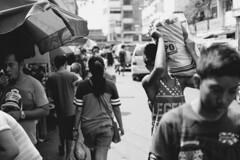 A busy day (Don Pablo Tan) Tags: life street bw man monochrome streetphotography cebu sack carry