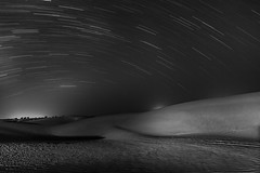 a state of trance (dr_zook81) Tags: sky india white black texture nature monochrome night dark landscape star mono sand desert dunes dune wide trails desolate trance rajasthan khuri desolute