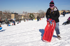 Sledding (dtanist) Tags: park new york city nyc newyorkcity sunset snow newyork kids brooklyn zeiss children kid child sony snowstorm contax carl sledding sled a7 45mm slope planar carlzeiss