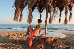 Woman in an orange scarf on the beach 14 (Romeodesign) Tags: travel sunset summer vacation holiday beauty female table happy freedom back seaside healthy model sand mood sitting outdoor young happiness bikini shore leisure
