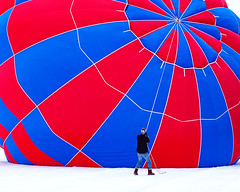Keeping it Steady (John D. Stocker) Tags: blue winter red snow hot cold color festival wisconsin work balloons photography air balloon rope hudson tension wi ballooning inflate tether hotairaffair johnstocker wwwpaintedspurphotographycom paintedspur
