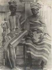 Interesting shot of an African family (lovedaylemon) Tags: africa family baby vintage walking found stripes stick headdress