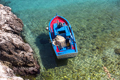 Boat at Levanzo harbour (kurjuz) Tags: blue red sea italy green boat rocks boots rope francesca sicily sicilia egadi levanzo