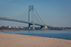 Verrazano-Narrows Bridge (Erin Cadigan Photography) Tags: auto road city nyc newyorkcity bridge newyork tower beach water horizontal architecture brooklyn river outdoors bay harbor daylight sand traffic suspension steel bluesky cable double structure deck shore transportation transit toll vehicle mta borough daytime hudson statenisland span narrows roadway verrazano verrazanonarrows fortwadsworth