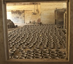 clay bases in the oven factory (Pejasar) Tags: africa light window factory pattern pots clay ghana westafrica base ovens acrra ovenfactory