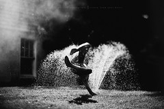 Happiness.... (privizzinis passion photography) Tags: light boy summer people blackandwhite feet water monochrome childhood kids children fun happy kid child play joy sprinkler barefeet freelensed
