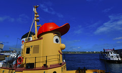 Halifax : Cartoon boat with red hat . . . (Clement Tang ** busy **) Tags: travel autumn seascape canada landscape novascotia bluesky halifax halifaxharbour touristspot nationalgeographic whiteclouds scenicspot handheldhdr concordians scenicsnotjustlandscapes colourfulboat cartoonboatwithredhat