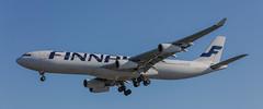 FINNAIR AIRBUS A340 OVER THE APPROACH LIGHTS LHR 27R (stormer43) Tags: finnair airbus a340 340 egll