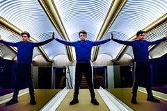 Triplicate (Dave G Kelly) Tags: boy colour reflection standing photography mirrors indoor multiples triplicate