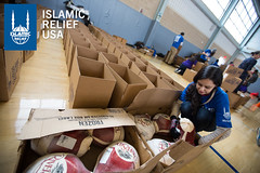 Islamic Relief USA volunteers pack turkeys for D.C. community for Thanksgiving.