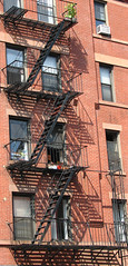 fire escape 1 (lisafree54) Tags: architecture stairs fire pattern shadows escape bricks gray free staircase fireescape zigzag interlocking cco freephotos