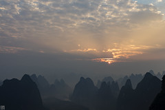 XiangGongShan Sunrise 相公山 (lycheng99) Tags: china travel sky sun mountains nature clouds contrast sunrise river landscape dawn lights guilin bluesky layers sunrays raysoflight guangxi chinatravel dawncolors layersofmountains xianggongshan 相公山