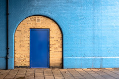 Door to another World (alexmerwin13) Tags: street door city greatbritain blue england urban favorite brick london texture car wall photography europe flickr shot unitedkingdom top united streetphotography favorites kingdom transportation gb portal bluewall streetshot arched topshot archeddoor tumblr