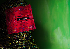 a bandari woman wearing a traditional mask called the burqa, Hormozgan, Minab, Iran (Eric Lafforgue) Tags: red people woman horizontal golden persian clothing asia veil mask iran muslim islam religion hijab culture persia headshot hidden indoors covered iranian copyspace sideview adultsonly oneperson traditionaldress burqa customs middleeastern sunni burka chador 20sadult youngadultwoman balouch hormozgan onewomanonly burqua  bandari  1people  iro thursdaymarket  minab colourpicture  borqe panjshambebazar boregheh irandsc06731