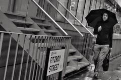 Tangent (Douguerreotype) Tags: street city uk england people urban blackandwhite bw london monochrome rain sign stairs umbrella mono britain candid steps gb british urbex