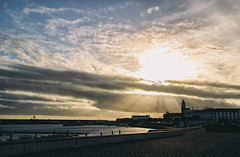 I thank the sun that illuminates the city . And it brings to light for those with capacity , In Ponta Delgada So Miguel Azores... (miguel.santos.1029) Tags: sunset sky sun clouds cityscape rays azores raysoflight pontadelgada photoaoacaso