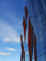 Home Of The Man Of Steel (trailrunner55) Tags: seattle blue red sky usa cloud reflection building glass architecture modern washington bluesky superman