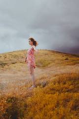 The Storm Child (Lulumire) Tags: california portrait storm colors girl face field clouds self flying arms expressive thunderstorm lululovering