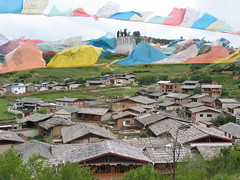 Zhongdian, Yunnan (Tomas Belcik) Tags: china houses roof people fashion coral skyline design dress rooftops market herbs turquoise buddha models culture shangrila altar adventure monastery prayerwheel tibetan earrings yunnan weaving medicinal loom garments necklaces brocade zhongdian gompa napalake villagescape gedansongzanlinmonastery zhongdiansoldtown tibetanhousetype