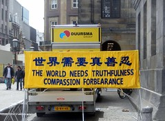 What the world really needs (Quetzalcoatl002) Tags: china amsterdam yellow message propaganda chinese compassion tolerance falungong truthfulness