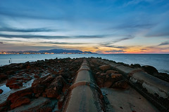 Sunset at Robina Beach (mozakim) Tags: longexposure sunset sky cloud beach beautiful rocks slow pipe malaysia shutter penang dramaticsky robina pulaupinang