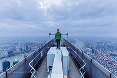 Conquering 2nd tallest building in Shanghai (DRoofing163) Tags: world china city roof urban building tower rooftop architecture clouds landscape high cityscape shanghai extreme center exploration financial jinmao height roofers roofing urbex roofer swfc
