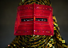 a bandari woman wearing a traditional mask called the burqa, Hormozgan, Minab, Iran (Eric Lafforgue) Tags: red portrait people woman beauty horizontal golden persian clothing eyes asia veil mask iran muslim islam religion hijab culture persia headshot hidden indoors covered iranian adultsonly oneperson traditionaldress burqa customs middleeastern frontview sunni burka chador 20sadult youngadultwoman balouch hormozgan onewomanonly lookingatcamera burqua  bandari  embroidering 1people  iro thursdaymarket  minab colourpicture  borqe panjshambebazar boregheh irandsc06783