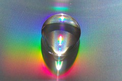Droplet (fxdx) Tags: macro colors reflections rainbow close cd refraction droplet