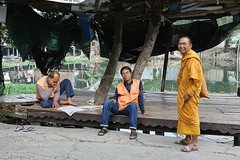 motorcycle taxi drivers and a monk (the foreign photographer - ) Tags: orange portraits canon thailand kiss bangkok taxi monk motorcycle uniforms shelter drivers khlong bangkhen thanon 400d