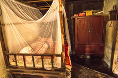 Bedroom in rural China (Photos4Health) Tags: china travel sunset shadow guy ecology sunrise dark li asia village place guilin yangshuo hill chinese elderly fisher stick tradition guizhou villager guangxi ecotourism xingping insidehouse