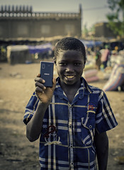 The Future Of Mali Part 1 (Baron Reznik) Tags: africa boy portrait face vertical model phone african telephone afrika mali ethnic djenne afrique  jenne  colorimage   djenn    jenn canon50mmf12l republicofmali moptiregion rgiondemopti   rpubliquedumali malikafasojamana    cerclededjenn djennecercle