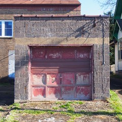 red's garage (photography_isn't_terrorism) Tags: school red abandoned doors garage block fading cinderblock garagedoor