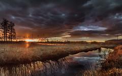 March storm (piotrekfil) Tags: sunset sky sun sunlight storm nature clouds reflections river landscape riverside pentax poland piotrfil