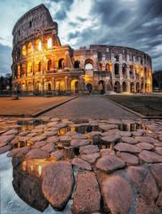 The Colosseum. (Massimo Cuomo Photography) Tags: blue italy panorama rome roma reflection water clouds sunrise puddle photography nikon dusk stones tripod shift colosseum hour tilt massimo colosseo cuomo vertorama