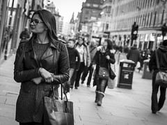 Window Shopping (Leanne Boulton) Tags: life street city uk light shadow portrait people urban blackandwhite bw woman white black detail texture monochrome face look female canon shopping 50mm mono scotland living blackwhite natural humanity bokeh outdoor expression glasgow candid culture streetphotography bodylanguage style streetlife scene depthoffield human shade 7d posture feeling gesture society tone facial stylish candidstreetphotography