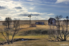 Old Homestead_169827.1 (rjmonner) Tags: blue trees winter sky abandoned windmill clouds barn rural landscape midwest farm neglected iowa heartland forgotten homestead agriculture economic blades deadend dormant unused agronomy cornbelt agronomic endofthelane windmillwednesday