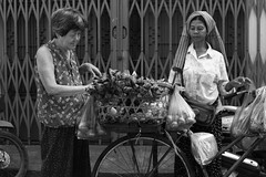Street  Phnom Penh (Julien Mailler) Tags: world street travel ladies blackandwhite vegetables bicycle asian julien women asia cambodge cambodia cambodian khmer asie seller phnom nationalgeographic penh asiatique reflectionsoflife lovelyphotos jules1405 cambodgien unseenasia earthasia mailler