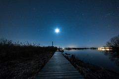 Towards the moon (jarnasen) Tags: longexposure sky copyright moon lake reed night reflections stars landscape nikon dof angle jetty tripod wide perspective himmel le astrophotography moonlight sverige nightphoto nikkor scandinavia linkping stergtland mnen roxen 14mm woodenjetty d810 nordiclandscape svartmynningen samyang14mm astrolandscape nybrobaden wwwfacebookcomjarnasenphotography