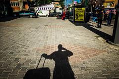 Shadowing large (Melissa Maples) Tags: cameraphone morning shadow woman selfportrait me apple turkey asia trkiye melissa busstop suitcase maples bursa iphone  iphone6