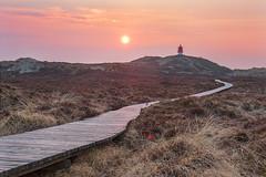 Sunset Amrum (bhansen.kiel) Tags: light sunset red sky sun lighthouse rot clouds canon reflections landscape island outdoor dunes dune insel northsea lensflare landschaft nordsee dne amrum bohlenweg