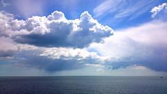 Showers at sea (SteveJM2009) Tags: uk light sea sun seascape colour rain clouds dorset april showers cloudscape stevemaskell 2016 poolebay naturethroughthelens
