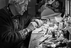 The Watchmaker at Work (Foto John) Tags: leica man london monochrome photoshop person blackwhite human friendly craftsman atwork hornsey peopleatwork clockmaker watchmaker crouchend tradesman lightandshade leicam8 summicronm35mmf2asph leicam82 silverefexpro2 blackandwhitethatsright