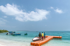 Boats at Bangaram Island, Lakshadweep (Anoop Negi) Tags: ocean travel blue sky orange sports coral clouds t island photography photo jetty indian lagoon anoop lakshadweep negi boata ezee123 bangaram laccadives