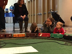 "Grandma Miller, Inde, Paul, and Mommy Watch the Trains • <a style=""font-size:0.8em;"" href=""http://www.flickr.com/photos/109120354@N07/24196674014/"" target=""_blank"">View on Flickr</a>"