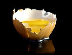 Cracked (Wim van Bezouw) Tags: food black broken yellow background egg